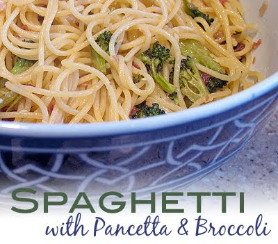 A close up photo of a bowl of spaghetti with pancetta and broccoli.
