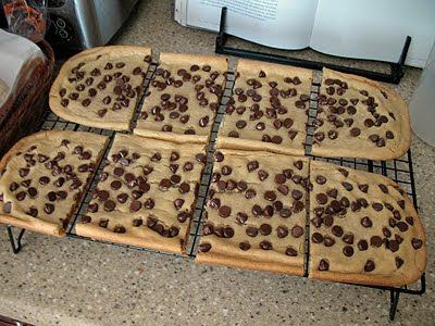 Freshly baked cookie sticks cut into squares on a cooling rack.