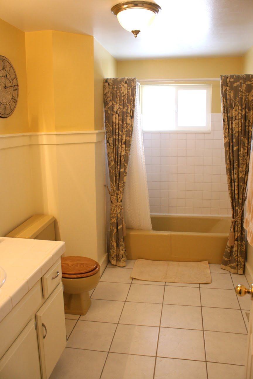 Mustard yellow tub and toilet updated bathroom for Restroom and bathroom