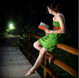 Woman with book at night