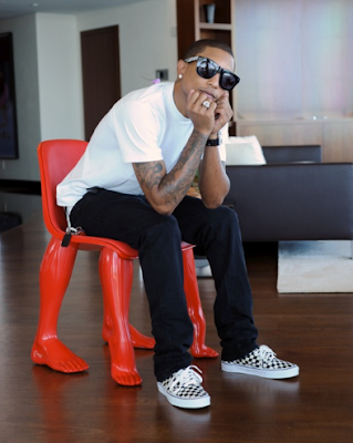 pharrell williams on a chair of his own design