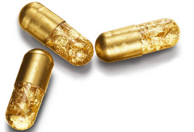Gold pill capsules by Tobias Wong
