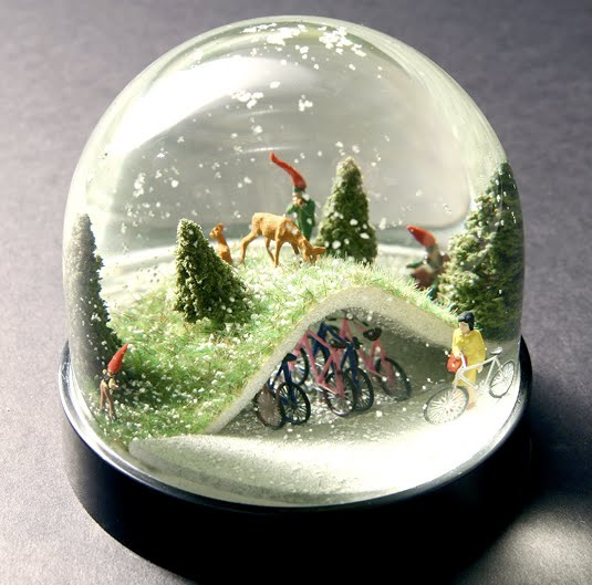 Man And Christmas Elf Explored In 14 Snowglobes By Various