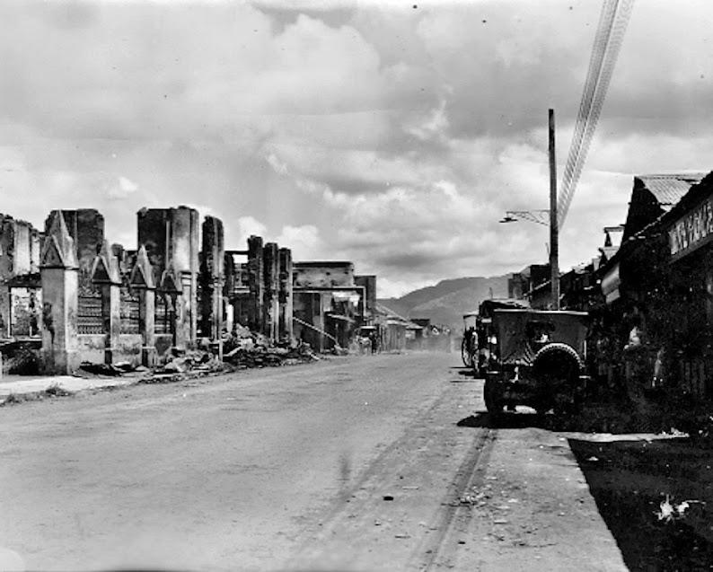 Original caption:  Photograph of Real Street3, Lipa, Batangas, looking east, showing destruction.